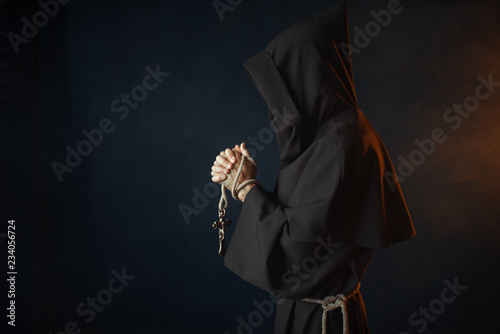 Stampa su Tela Medieval monk praying with closed eyes