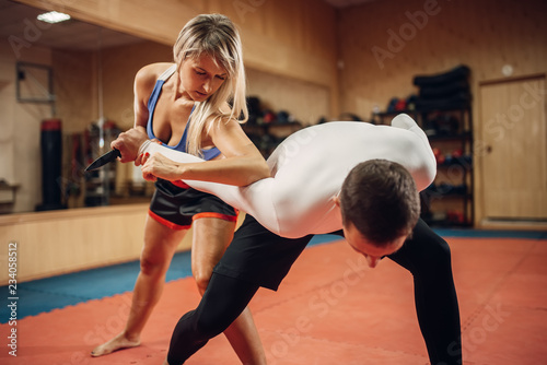 Garden Poster Martial arts Woman makes elbow kick, self-defense workout