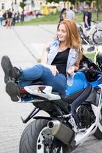 Red Hair Girl On Motobike. Pho...