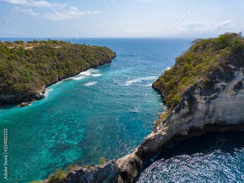 Tuinposter Centraal-Amerika Landen Aerial view to beautiful rock in ocean on Atuh beach, Nusa Penida, Bali, Indonesia