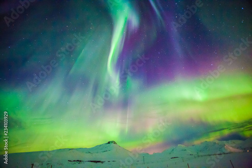 Photo  Aurora Borealis or better known as The Northern Lights for background view in Ic