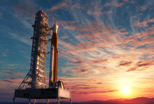 Space Launch System On Launchpad Over Background Of Sunrise