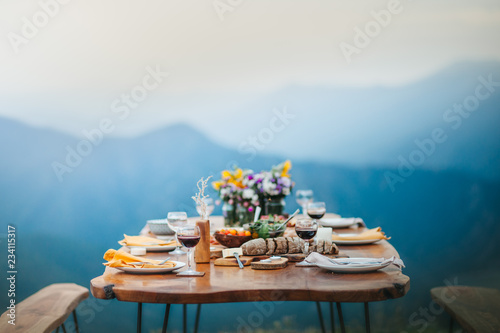 Leinwand Poster Rich Romantic Dinner on Mountain Top