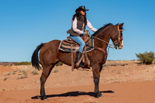 Young Native American Woman Ri...