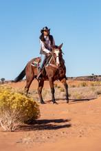 Native American Woman Riding Horse In Desert