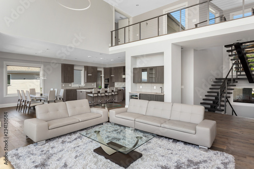Living Room Dining And Kitchen In New Luxury Home With Open Concept Floor
