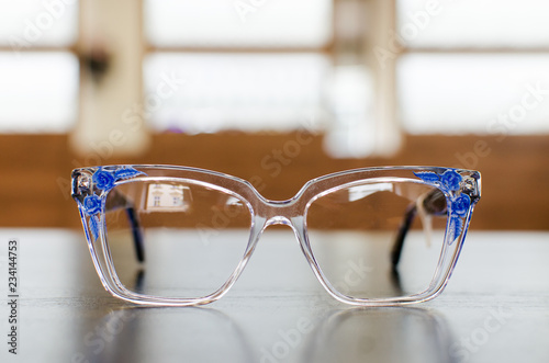 Fotografija  Eccentric eyeglasses with blue flowers