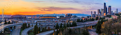 Seattle downtown skyline panorama at sunset from Dr. Jose Rizal or 12th Avenue South Bridge with traffic trail lights - 234152311