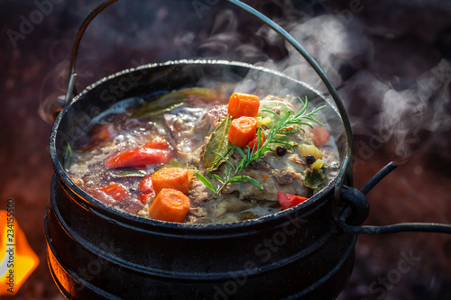 Delicious and fresh hunter's stew on bonfire