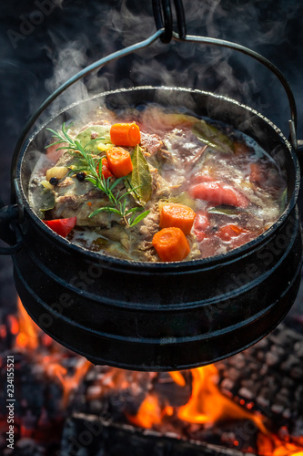 Delicious and fresh hunter's stew on campfire