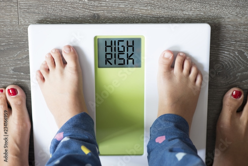 Stampa su Tela Childhood obesity high risk for health problems with child's feet on weight scal