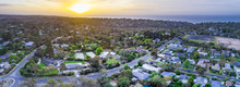 Sunset Over Houses On Ocean Coastline - Aerial Panorama