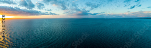 Fotografie, Tablou Wide aerial panorama of sunset over ocean - minimalistic seascape