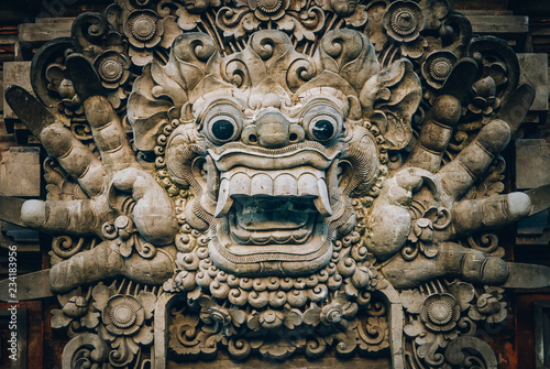 Closeup portrait of Hindu Buddhist traditional stone sculpture Wallpaper Mural