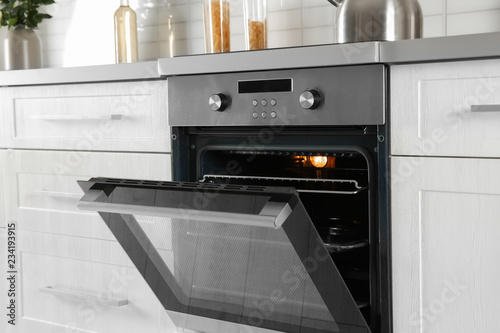 Vászonkép Open modern oven built in kitchen furniture