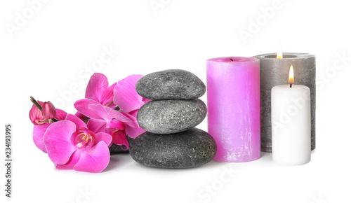 Fototapeta Composition with spa stones and candles on white background obraz na płótnie