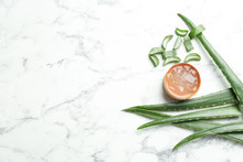 Flat Lay Composition With Aloe Vera Leaves On Marble Background. Space For Text