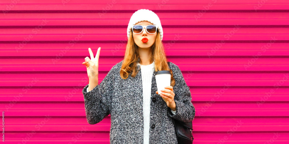 Fototapety, obrazy: Fashion and people concept - cool stylish woman blowing red lips sends an air kiss on colorful pink wall background