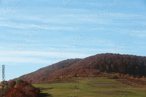 Beautiful landscape with blue sky over mountain slopes