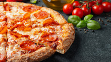 Tasty Pepperoni Pizza And Cooking Ingredients Tomatoes Basil On Black Concrete Background