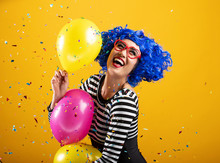 Colorful Fun Portrait Of Happy Woman Holding Balloons And Playing In Confetti
