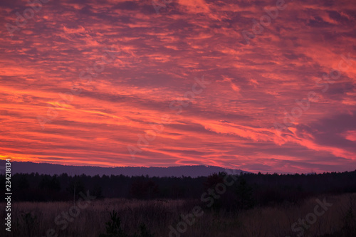 Spoed Foto op Canvas Koraal Amazing sunset clouds in mountain with forest, Czech landscape