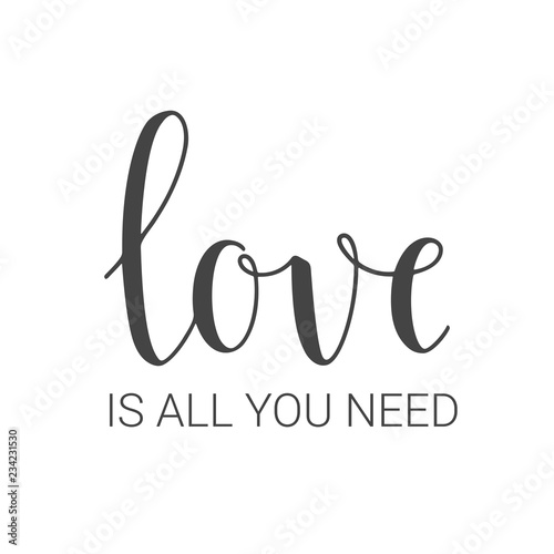 Photo  Handwritten lettering of Love Is All You Need on white background
