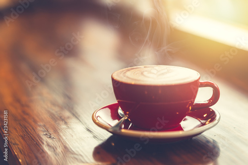 aroma morning coffee on wooden table smoke at windows vintage tone.
