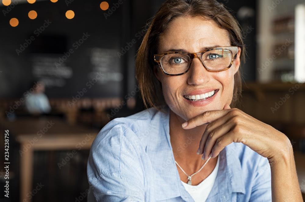 Fototapeta Happy mature woman wearing eyeglasses