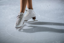White Skates On The Ice. A Young Dancer Is Having Her Performance.