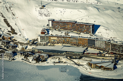 The view on winter houses located in ski resort in France, Tignes. Snowy, sunny day.