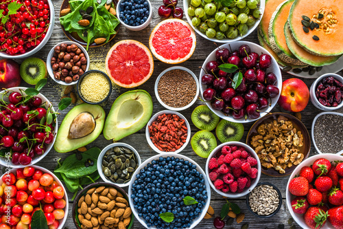 Fototapeta Selection of healthy food. Superfoods, various fruits and assorted berries, nuts and seeds. obraz