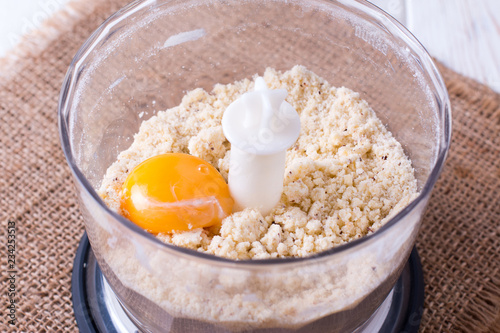 Fotografie, Obraz  Mixing butter and eggs in bowl in food processor