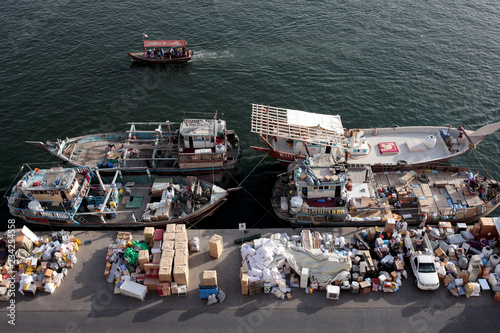 Goods wait to be loaded on dhows bound for Iran along the creek in