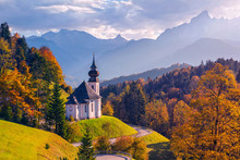 Autumn In Alps. Image Of The Bavarian Alps With Maria Gern Church And Watzmann Mountain During Beautiful Autumn Sunset.