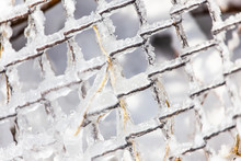 Snow And Ice On A Metal Grid A...