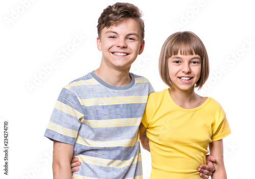 Portrait of happy boy and girl hugging Tableau sur Toile