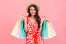 Lady Posing Isolated Over Pink Background Wall Holding Shopping Bags.