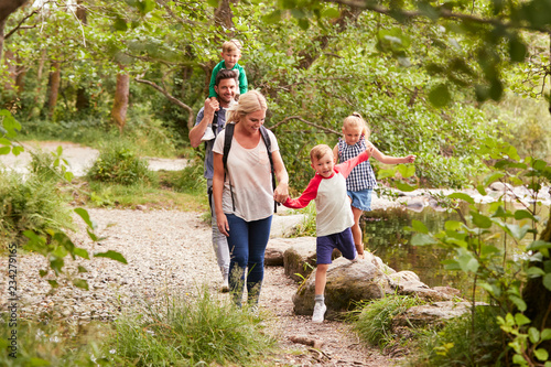 Fényképezés Family Hiking Along Path By River In UK Lake District