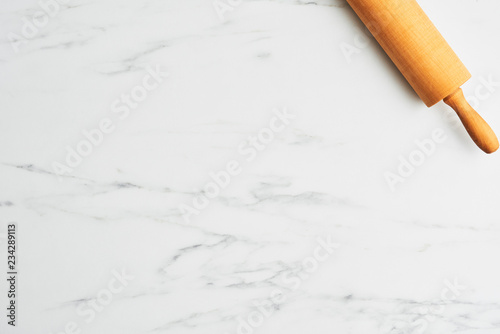 With Rolling Pin On White Marble Table