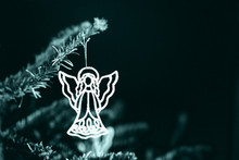 Silhouette Of A Carved Angel On A Dark Background