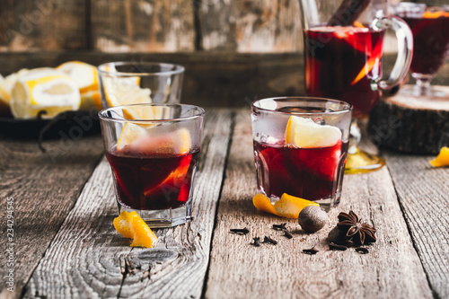 Christmas hot drinks with citrus fruits and spices, mulled wine