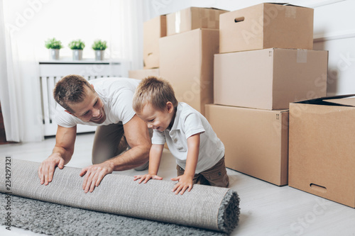 Fotografie, Obraz Moving concept, Father and son moving to a new home