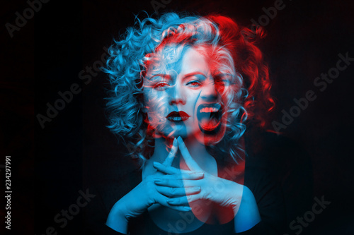 Calm and angry girl. Double color exposure. Poster Mural XXL
