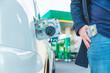 money in car tank. dollars in man pocket. gasoline price hike