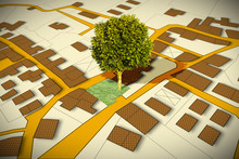 Cadastral Map With A Tree On A Green Area - Concept Image