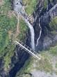 Bridge over ravine near waterfall