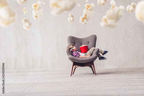 Sleeping little boy with popcorn