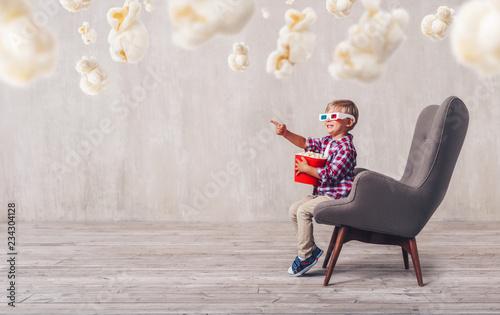 Happy child with popcorn
