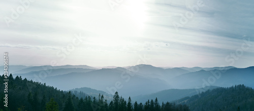 Fotografie, Tablou aerial view to the forest, mountains and Valley Covered with Foggy